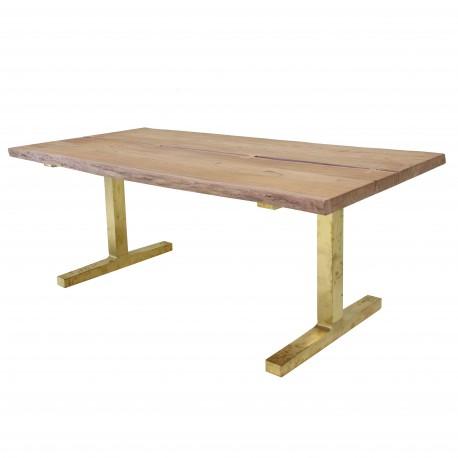 Stół z drewnianych desek i podstawą z mosiądzu